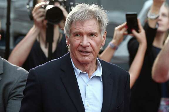 "FILE - In this December 10, 2015 file photo, Harrison Ford greets fans during a Star Wars fan event in Sydney. A film production company has admitted health and safety breaches over an accident on the set of ""Star Wars: The Force Awakens"" in which Harrison Ford broke his leg. The actor was struck by a hydraulic door on the set of the Millennium Falcon — his character Han Solo's spaceship — at Pinewood Studios near London in June 2014. At a court hearing Tuesday, July 26, 2016 prosecutor Andrew Marshall said the door ""could have killed somebody"" had an emergency stop button not been hit. (AP Photo/Rob Griffith, File)"