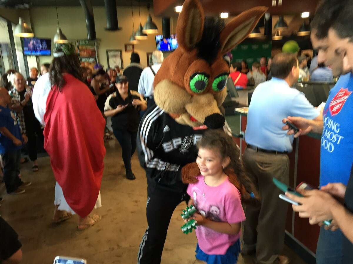 Celebrities including Spurs Jesus and Spurs Coyote participated in a wing eating contest July 26, 2016 at Wingstop.
