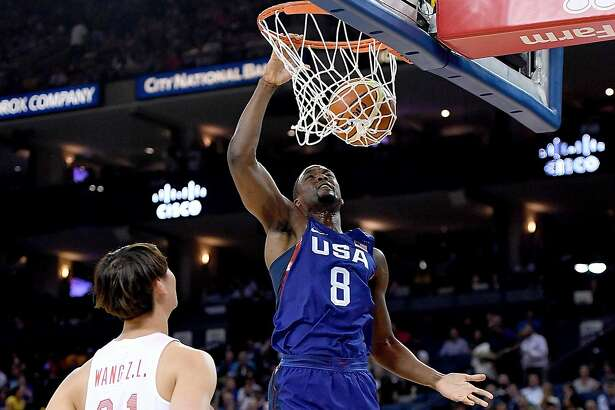 OAKLAND, CA - JULY 26:  Harrison Barnes #8 of the United States Men's National Team goes up for a slam dunk against the China Men's National Team during the first half of a USA Basketball showcase exhibition game at ORACLE Arena on July 26, 2016 in Oakland, California.  (Photo by Thearon W. Henderson/Getty Images)