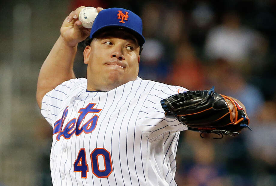 New York Mets starting pitcher Bartolo Colon delivers during the first inning of the second baseball game of a doubleheader against the St. Louis Cardinals, Tuesday, July 26, 2016, in New York. (AP Photo/Kathy Willens) ORG XMIT: NYM117 Photo: Kathy Willens / Copyright 2016 The Associated Press. All rights reserved. This m
