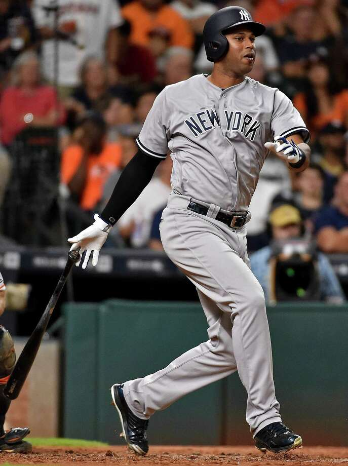 New York Yankees' Aaron Hicks watches his three-run triple during the fifth inning of a baseball game against the Houston Astros, Tuesday, July 26, 2016, in Houston. (AP Photo/Eric Christian Smith) ORG XMIT: TXES115 Photo: Eric Christian Smith / FR171023 AP