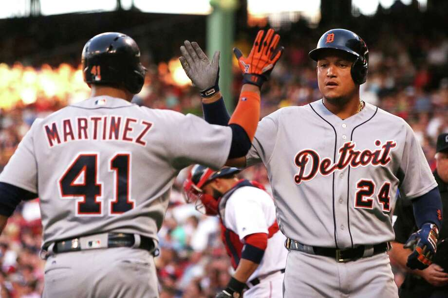 BOSTON, MA - JULY 26:  Miguel Cabrera #24 high fives Victor Martinez #41 of the Detroit Tigers after hitting a two-run home run in the first inning during the game against the Boston Red Sox at Fenway Park on July 26, 2016 in Boston, Massachusetts.  (Photo by Adam Glanzman/Getty Images) ORG XMIT: 607682323 Photo: Adam Glanzman / 2016 Getty Images