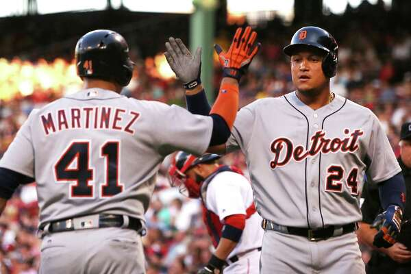 BOSTON, MA - JULY 26:  Miguel Cabrera #24 high fives Victor Martinez #41 of the Detroit Tigers after hitting a two-run home run in the first inning during the game against the Boston Red Sox at Fenway Park on July 26, 2016 in Boston, Massachusetts.  (Photo by Adam Glanzman/Getty Images) ORG XMIT: 607682323