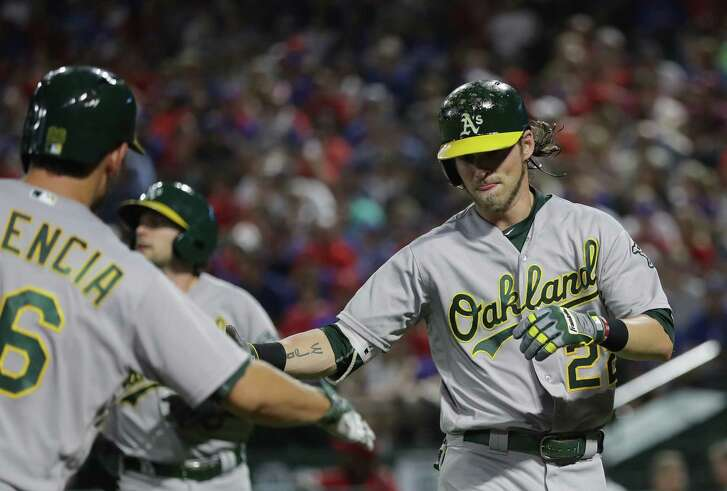 ARLINGTON, TX - JULY 26:  Josh Reddick #22 of the Oakland Athletics celebrates a two-run homerun with Danny Valencia #26 against the Texas Rangers in the fourth inning at Globe Life Park in Arlington on July 26, 2016 in Arlington, Texas.  (Photo by Ronald Martinez/Getty Images)