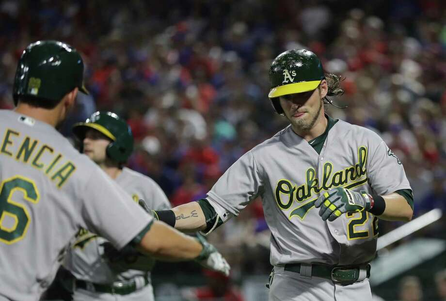 ARLINGTON, TX - JULY 26:  Josh Reddick #22 of the Oakland Athletics celebrates a two-run homerun with Danny Valencia #26 against the Texas Rangers in the fourth inning at Globe Life Park in Arlington on July 26, 2016 in Arlington, Texas.  (Photo by Ronald Martinez/Getty Images) Photo: Ronald Martinez / Getty Images / 2016 Getty Images