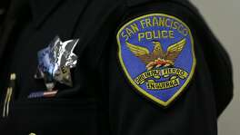 A patch and badge is seen on the uniform of a San Francisco police officer during a news conference Friday, April 29, 2016, in San Francisco.  Chief Greg Suhr has ordered effective immediately that all officers attend an anti-harassment class, even as he released more transcripts of a former lieutenant and two former officers exchanging racist text messages. Investigators found the text messages on the personal phones of the officers during criminal probes of former officer Jason Lai and retired Lt. Curtis Liu. (AP Photo/Eric Risberg)