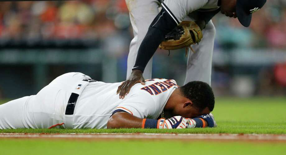 Astros third baseman Luis Valbuena is felled by a hamstring injury while trying to run to first base in the second inning. Photo: Karen Warren, Staff / © 2016 Houston Chronicle