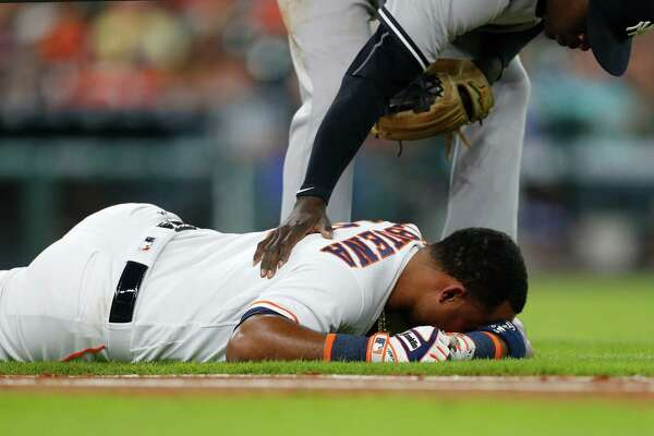 Astros third baseman Luis Valbuena is felled by a hamstring injury while trying to run to first base in the second inning.