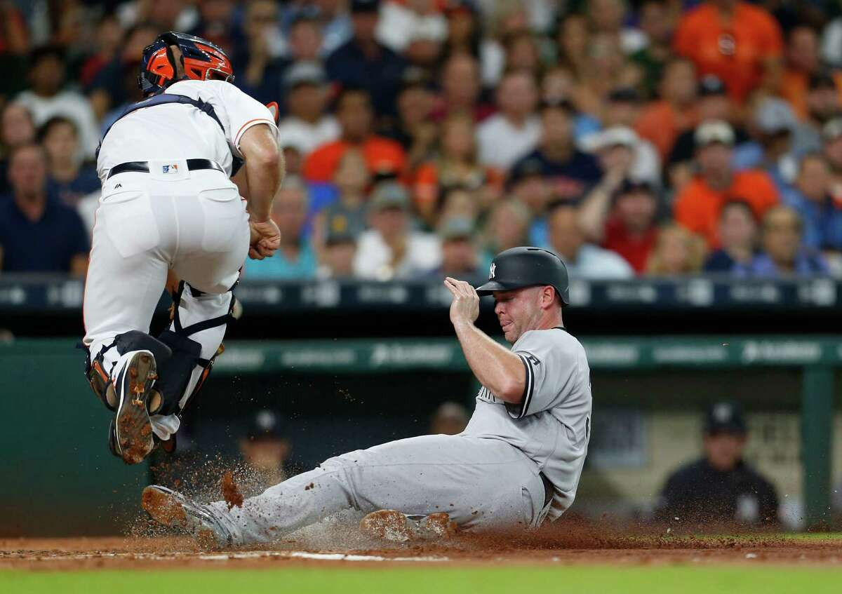 New York Yankees catcher Brian McCann (34) slides safely into home to score on Didi Gregorius' sac fly during the second inning of an MLB game at Minute Maid Park, Tuesday, July 26, 2016, in Houston. ( Karen Warren / Houston Chronicle )