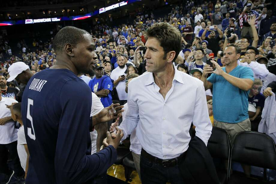Kevin Durant shakes hand with Warriors General Manager Bob Myers after the USA Mens National basketball team played the China Mens National team at Oracle Arena in an exhibition game in Oakland , Calif., on Tuesday, July 26, 2016. The teams head to Rio for the Olympics beginning on August 6. Photo: Carlos Avila Gonzalez, The Chronicle