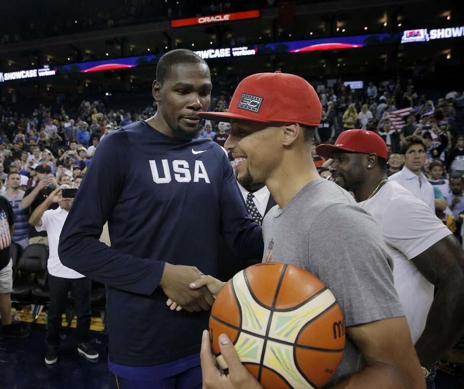 Kevin Durant shakes hand with Stephen Curry after the USA Mens National basketball team played the China Mens National team at Oracle Arena in an exhibition game in Oakland , Calif., on Tuesday, July 26, 2016. The teams head to Rio for the Olympics beginning on August 6. Photo: Carlos Avila Gonzalez, The Chronicle