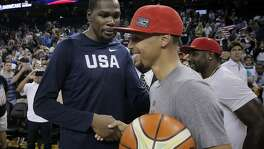 Kevin Durant shakes hand with Stephen Curry after the USA Mens National basketball team played the China Mens National team at Oracle Arena in an exhibition game in Oakland , Calif., on Tuesday, July 26, 2016. The teams head to Rio for the Olympics beginning on August 6.