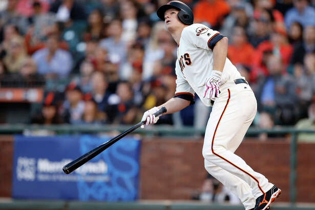 Matt Cain follows the flight of his three-run home run in the second inning. It was his first homer since July 21, 2012