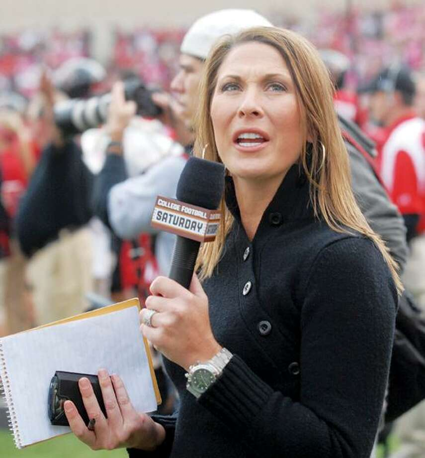 BACK IN HER OLD STOMPING GROUNDS: Fox Sports Southwest personality Emily Jones McCoy works the sidelines at Jones AT&T Stadium in Lubbock during the recent Texas Tech-University of New Mexico football game. Jones, who recently married Mike McCoy of Fort Worth, is a 1995 graduate of Plainview High School and Tech and worked as sports director for KCBD-TV in Lubbock before going to work for Fox Sports.