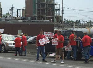 """Union workers from Momentive Performance Materials in Waterford hold a rally Friday iback in June ahead of contract talks that have ended with Momentive giving its """"final"""" offer on a three year deal with a 5.5 percent raise."""