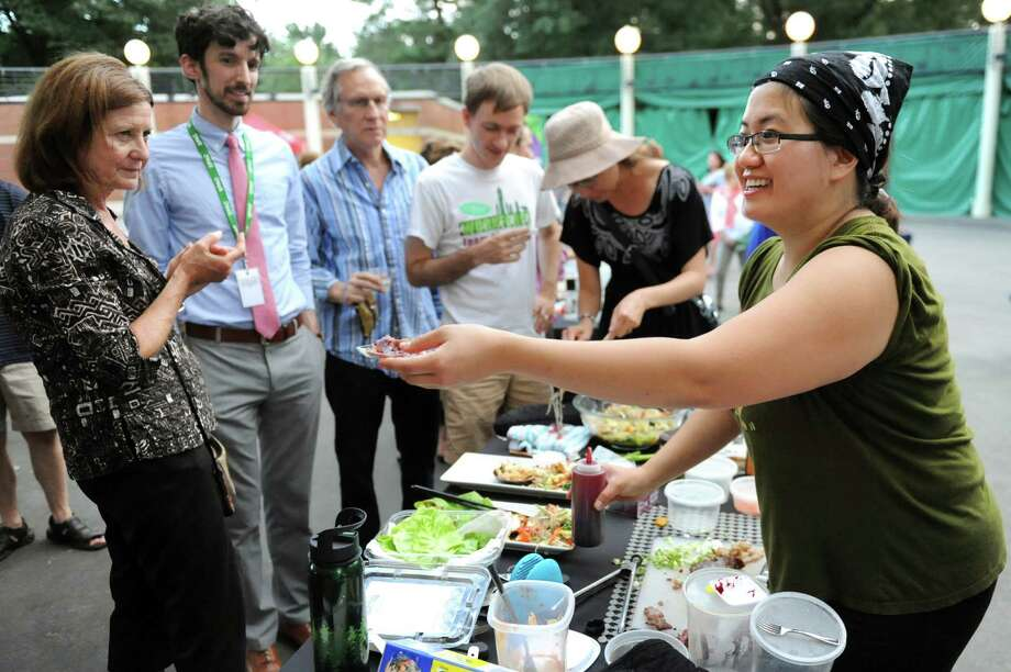 Angela Crupe of Rensselaer, right,works the crowd during the Grill Games final on Thursday, Aug. 20, 2015, at Saratoga Performing Arts Center in Saratoga Springs, N.Y. (Cindy Schultz / Times Union) ORG XMIT: MER2015082118211982 Photo: Cindy Schultz / 00033061A