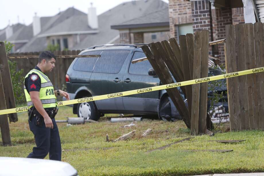 A van smashed into the back of a home near the intersection of Promenade Boulevard and Hunters River Court about 6:15 a.m. Wednesday, July 27, 2016, in Stafford.(Brett Coomer/Houston Chronicle)