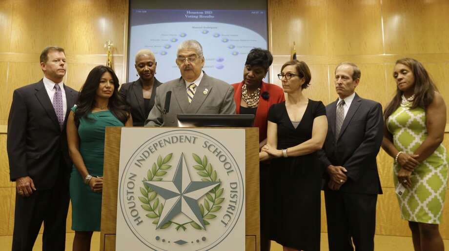 Manuel Rodriguez, HISD board president, surrounded with other board members speaks to the media about the board naming Richard Carranza as the sole finalist for HISD superintendent Tuesday, July 27, 2016. Photo: Melissa Phillip, Houston Chronicle