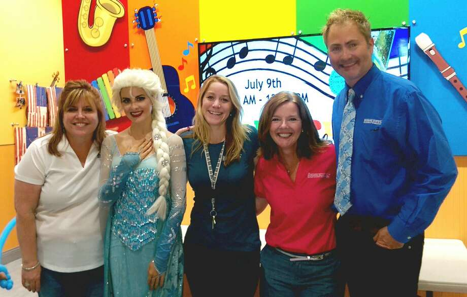 "The Goddard School of Houston-Greater Heights held a grand opening celebration July 9, which included special guest Elsa, second from left, from Disney's ""Frozen."" Attending the celebration were Valerie Paulsen, the preschool's director of operations; left, Elsa, Christi Barrett, owner; Jeanie Lundquist, director of education; and Larry Wisowaty, representative from Goddard Systems Inc. Photo: Goddard"