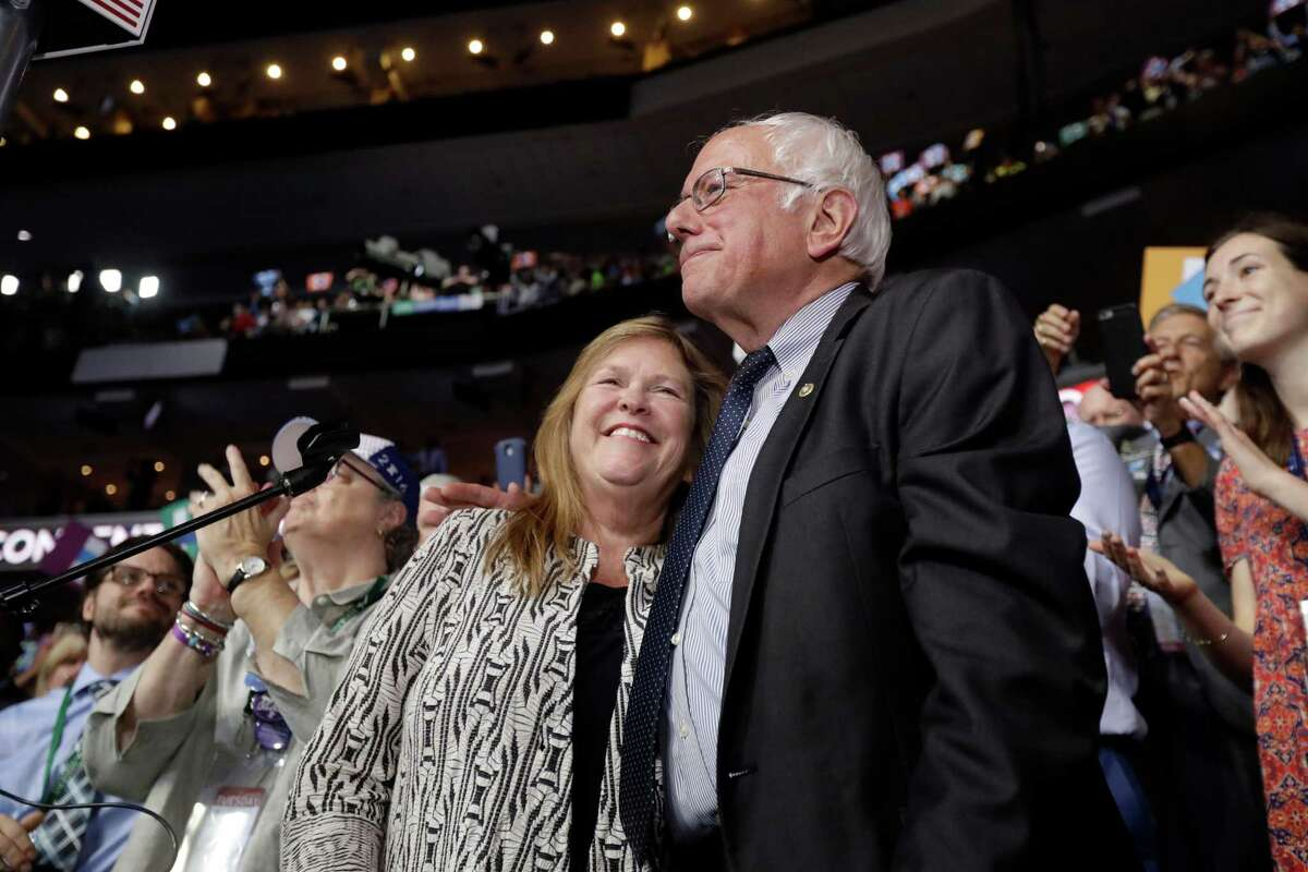 Former Democratic presidential candidate, Sen. Bernie Sanders, I-Vt., hugs wife Jane after standing with the Vermont delegation and asking that Hillary Clinton become the unanimous choice for President of the United States during the second day of the Democratic National Convention in Philadelphia , Tuesday, July 26, 2016.