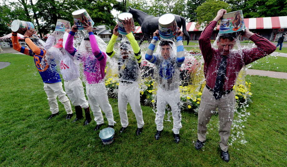 Five jockeys and a former jockey took part in the ALS awareness ice pour in the paddock of the Saratoga Race Course Friday afternoon Aug. 15, 2014, in Saratoga Springs, N.Y.   The participants from left to right are: John Velazquez, Mike Luzzi, Jose Ortiz, Manuel Franco, Irad Ortiz Jr. and former jockey and present television personality Richard Migliore. (Skip Dickstein/Times Union) Photo: SKIP DICKSTEIN