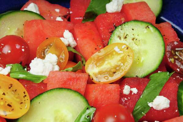 Watermelon and tomato salad with basil oil, Thursday, Aug. 15, 2013. (Will Waldron/Times Union)