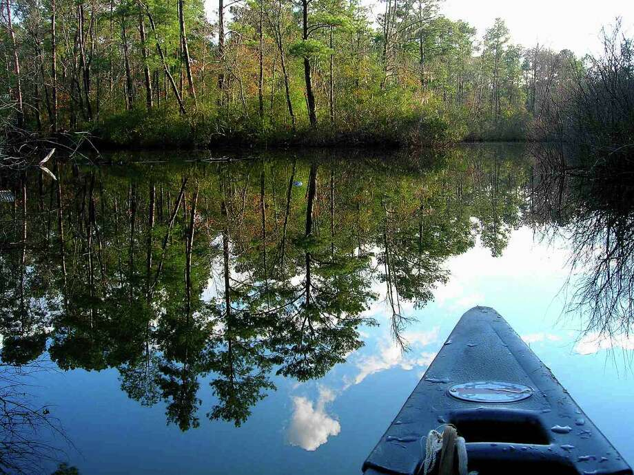 A quiet day at Chain-O-Lakes (now the Retreat at Artesian Lakes) located on the edge of Texas Big Thicket National Preserve Photo: Rick Skeen