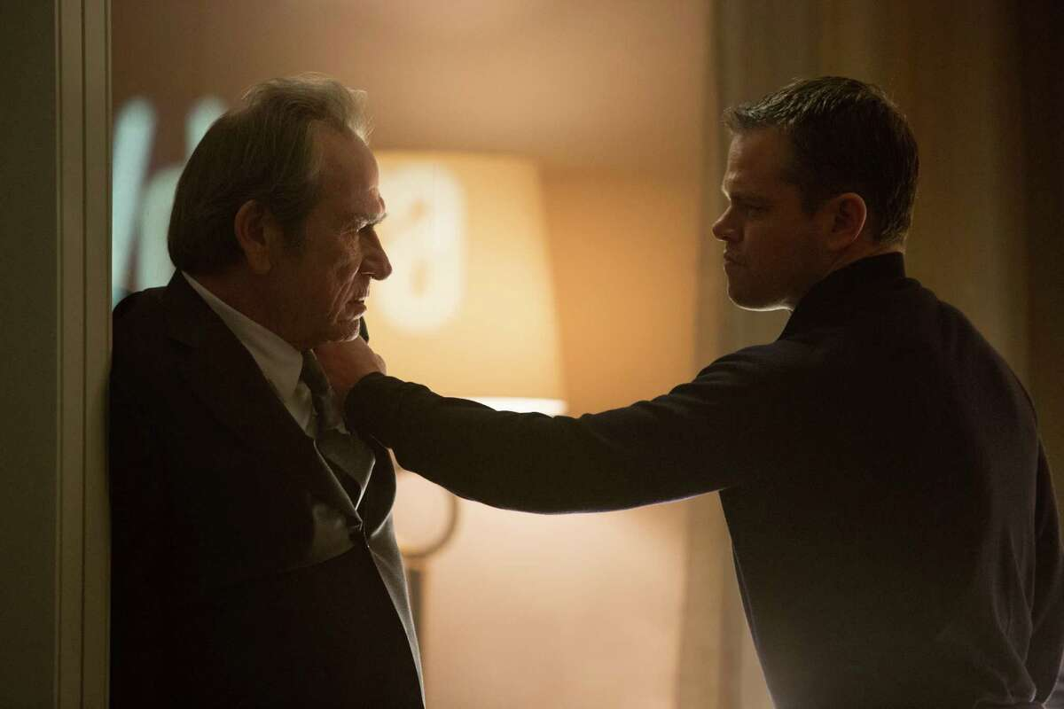 """In this image released by Universal Pictures, Tommy Lee Jones, left, and Matt Damon appear in a scene from """"Jason Bourne."""" (Melinda Sue Gordon/Universal Pictures via AP)"""