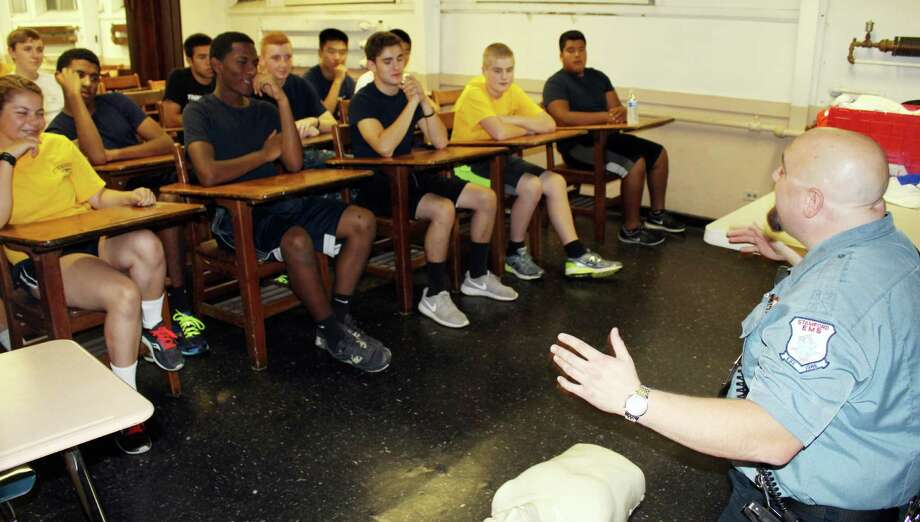 John DeMaio, a former sea cadet who works at Stamford EMS, taught a class to sea cadets in their headquarters in Stamford, CT on Monday, July 25, 2016. Photo: Erin Kayata / Hearst Connecticut Media / Darien News