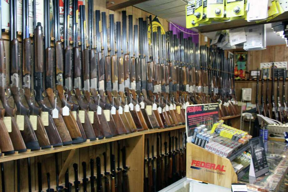 Rifles line the walls of Bob's Unpainted Furniture and Gun Exchange in Darien, Conn., on July 21, 2016. Photo: Justin Papp / Hearst Connecticut Media / Darien News