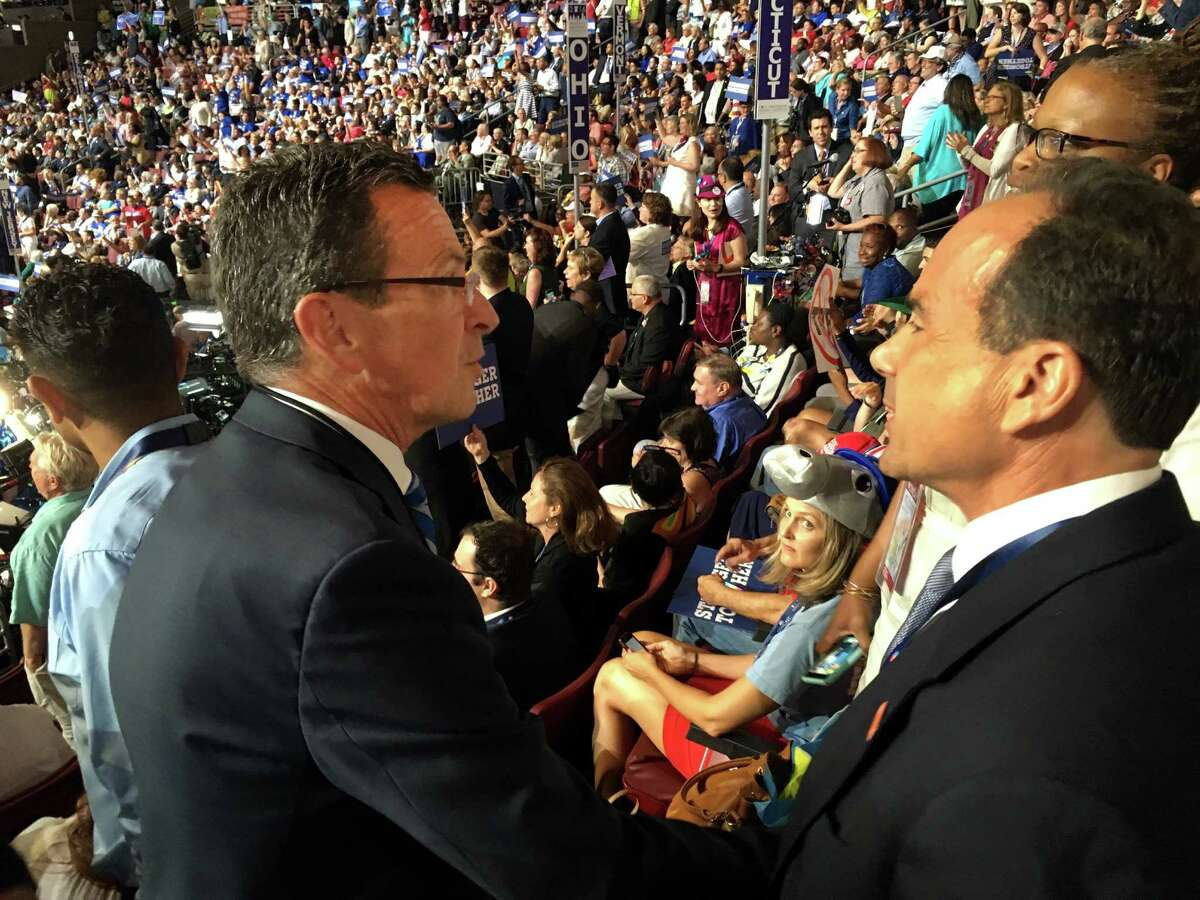 Connecticut Gov. Dannell P. Malloy greets Bridgeport Mayor Joe Ganim at the Democratic National Convention inside the Wells Fargo Arena in Philadelphia, PA on Monday, July 25, 2016.