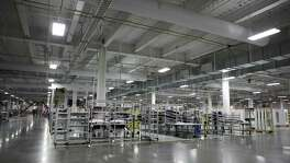 Machinery stands inside the Tesla Motors Inc. Gigafactory in Sparks, Nev. Tesla has officially opened Gigafactory, a little more than two years after construction began. San Antonio had been one of the finalists for the project.