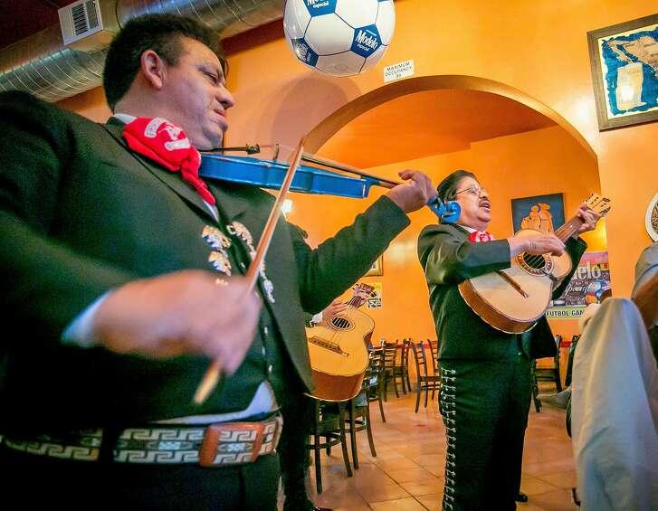 A Mariachi band serenades people at La Rondalla in San Francisco,  Calif., on Saturday, June 14th, 2014.