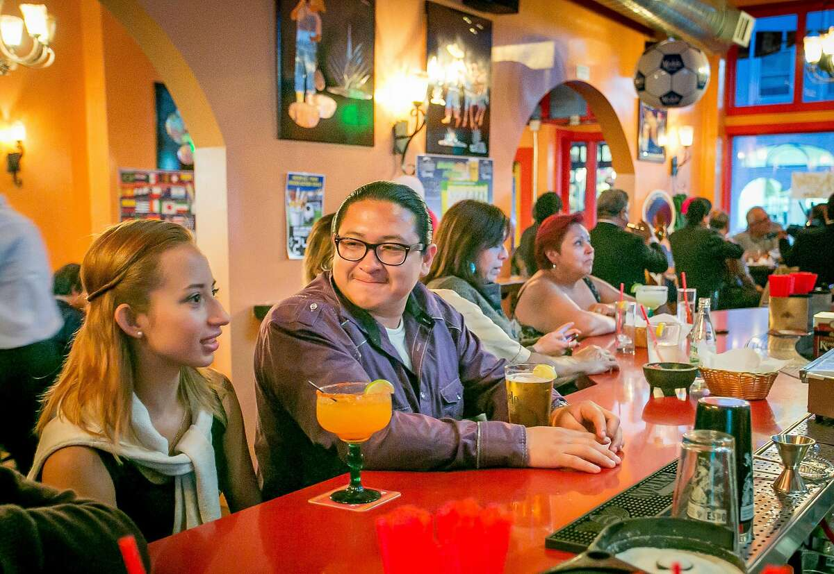 A couple have drinks at La Rondalla in San Francisco, Calif., on Saturday, June 14th, 2014.