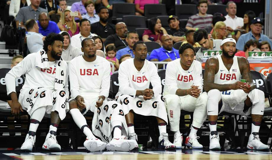 LAS VEGAS, NV - JULY 22:  (L-R) DeAndre Jordan #6, Kevin Durant #5, Harrison Barnes #8, DeMar DeRozan #9 and DeMarcus Cousins #12 of the United States look on from the bench during a USA Basketball showcase exhibition game against Argentina at T-Mobile Arena on July 22, 2016 in Las Vegas, Nevada. The United States won 111-74. Photo: Ethan Miller, Getty Images / 2016 Getty Images