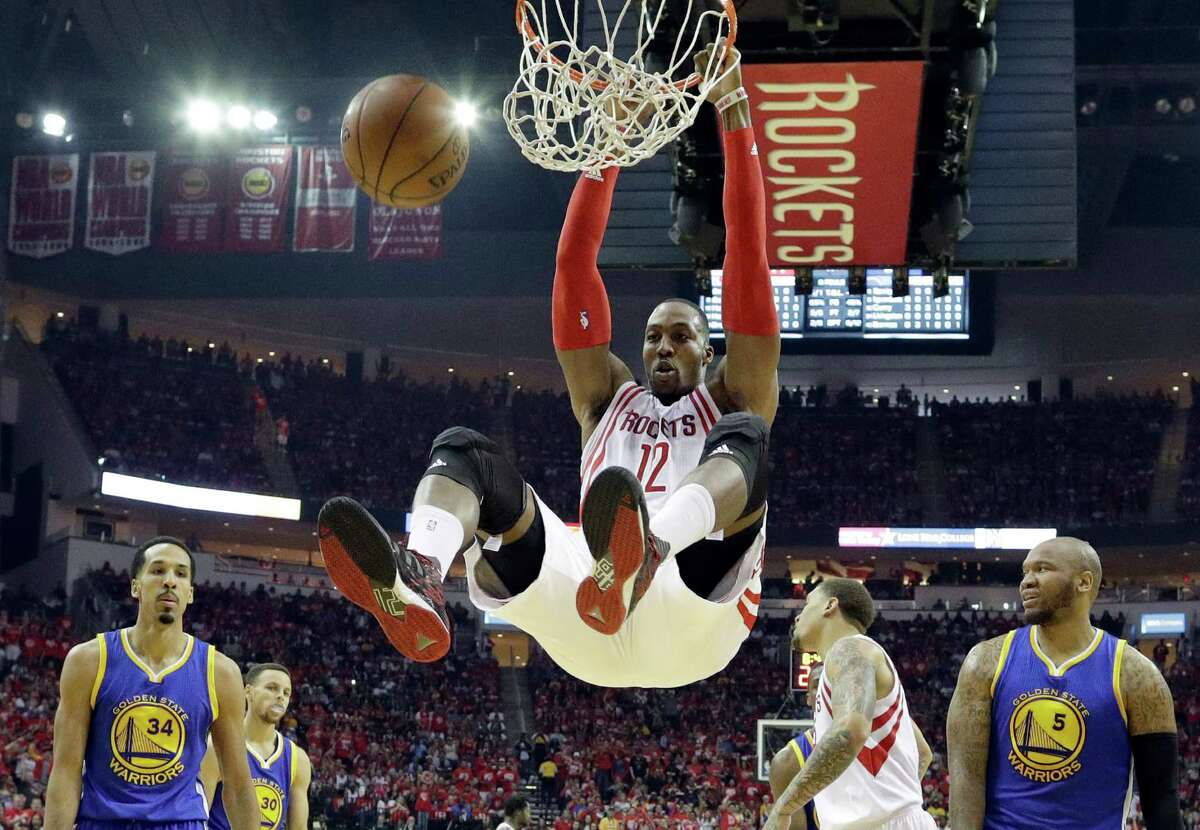 FILE - In this April 24, 2016, file photo, Houston Rockets' Dwight Howard dunks against the Golden State Warriors during the first half in Game 4 of a first-round NBA basketball playoff series in Houston. Toronto's DeMar DeRozan, Atlanta's Al Horford, Memphis point guard Mike Conley and Houston's Dwight Howard are among those who figure to become free agents this summer when the NBA's new television deal will kick in. (AP Photo/David J. Phillip, File)