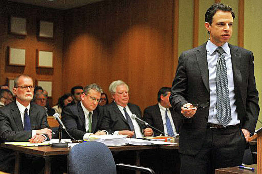 Joshua Koskoff, foreground, who represents Sandy Hook families suing Remington Arms, and attorneys for the gunmaker during a February appearance in Bridgeport Superior Court. Photo: / Ned Gerard
