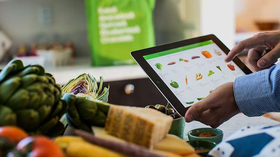 File photo of Instacart in use on a tablet. Photo: Smith, Michael