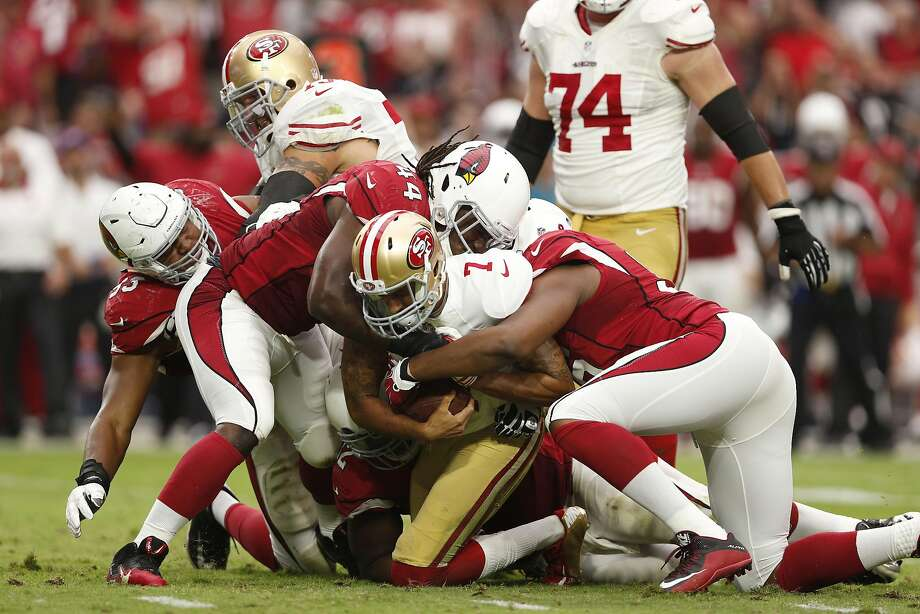 GLENDALE, AZ - SEPTEMBER 27:  Quarterback Colin Kaepernick #7 of the San Francisco 49ers is sacked by outside linebacker Markus Golden #44 of the Arizona Cardinals during the NFL game at the University of Phoenix Stadium on September 27, 2015 in Glendale, Arizona.  The Carindals defeated the 49ers 47-7.  (Photo by Christian Petersen/Getty Images) Photo: Christian Petersen, Getty Images