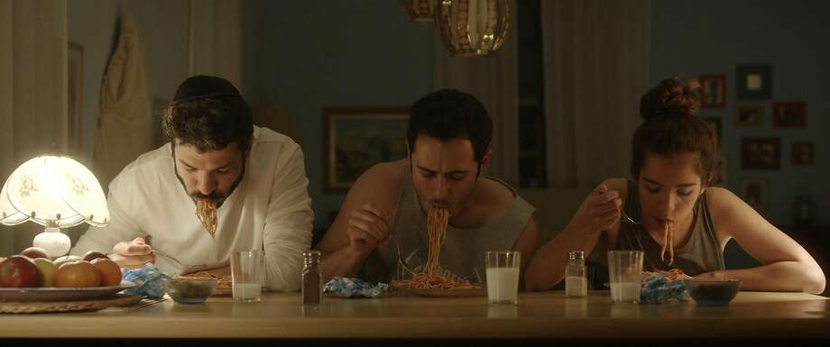 "Netanel (Roy Assaf, left), Shai (Assaf Ben-Shimon) and Dorona (Rotem Zissman-Cohen) search for their biological father in ""The Kind Words."" Photo: Strand Releasing"
