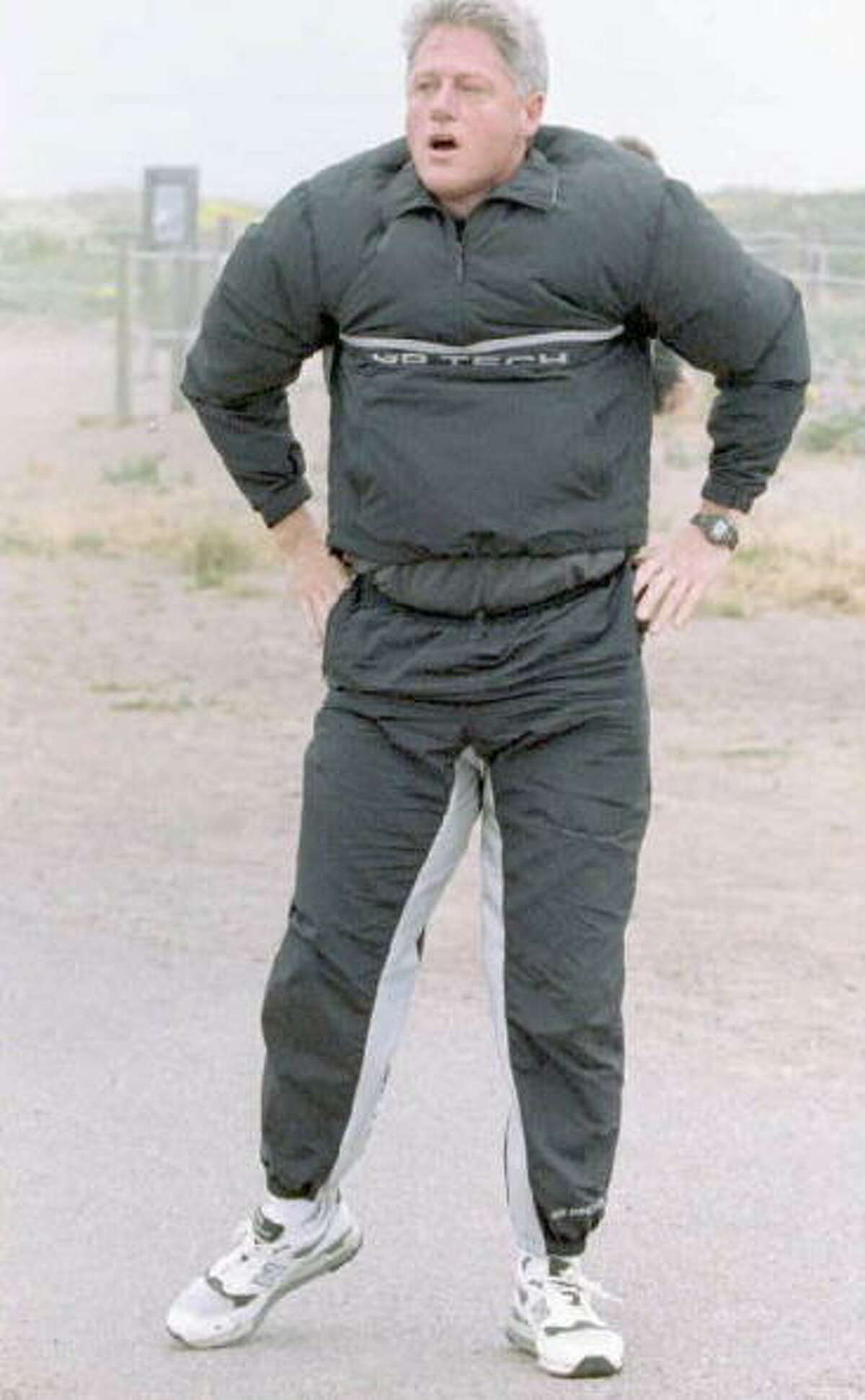 1995: Wind off of the San Francisco bay catches in US President Bill Clinton's jogging suit 26 June after a morning jog near the Golden Gate Bridge. President Clinton is in San Francisco to address the 50th anniversary celebration of the United Nations.