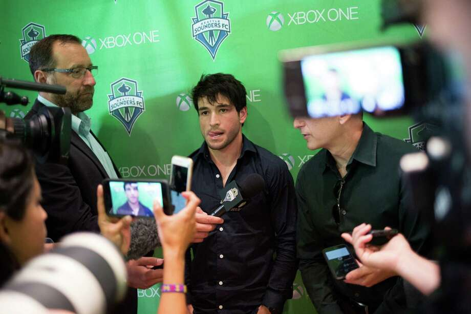 Nicolas Lodeiro answers questions through a translator following press conference welcoming him as a midfielder to the Seattle Sounders, at The Ninety on Wednesday, July 27, 2016. Photo: GRANT HINDSLEY, SEATTLEPI.COM / SEATTLEPI.COM