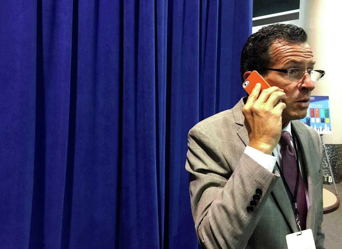 Gov. Dannel P. Malloy does a phone interview with a reporter from inside the Wells Fargo Arena in Philadelphia, PA on Tuesday, July 26, 2016.