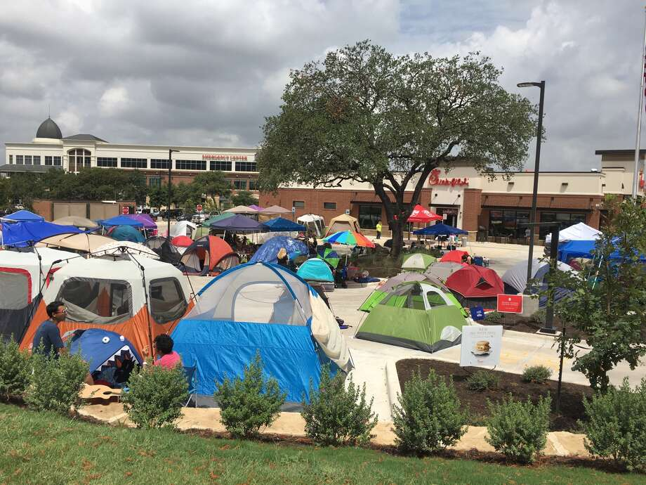 People brave the summer elements for a chance at winning one free Chick-fil-a meal per week a year on July 27, 2016 at the grand opening of a location at 10503 Northwest Military Highway on July 27, 2016. Photo: Josh Baugh