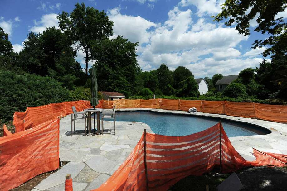 Stamford-based Ocean North Pools is building a pool and fire pit at a home on West Hill Circle. Photo: Michael Cummo / Hearst Connecticut Media / Stamford Advocate
