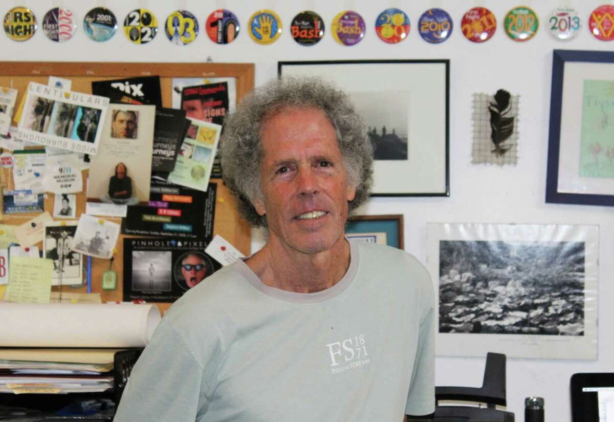 Graphic artist Miggs Burroughs - in his studio on July 14, 2016 in Westport, Conn. - is behind numerous Westport designs, including the town flag and Tunnel Vision downtown.
