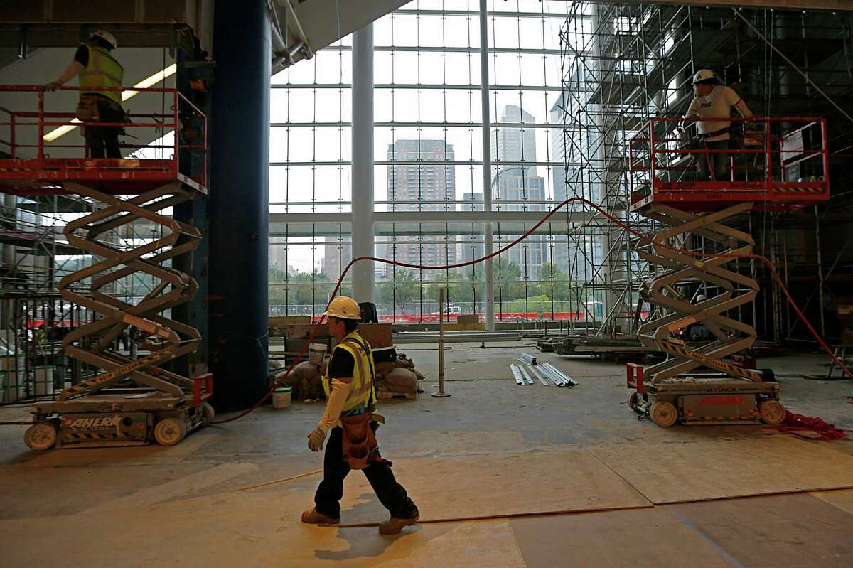 Construction work continues on an atrium that will hold new artworks commissioned for the George R. Brown Convention Center.