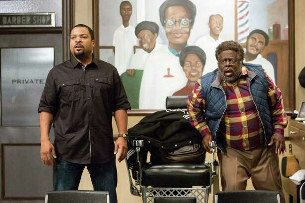 """In this image released by Warner Bros., Ice Cube, left, and Cedric The Entertainer appear in a scene from """"Barbershop: The Next Cut."""" (Chuck Zlotnick/Warner Bros. via AP) ORG XMIT: NYET931"""