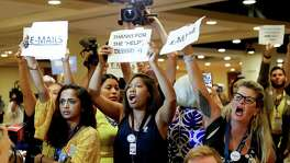 Protesters yell as DNC Chairwoman, Debbie Wasserman Schultz, D-Fla., arrives for a Florida delegation breakfast at the Democratic National Convention Monday in Philadelphia. Coverage of her own email scandal illustrates a media bias, according to a reader.