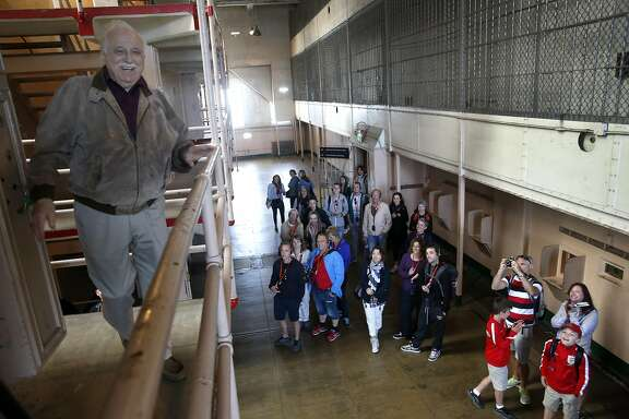 Visitors wish former prison guard George DeVincenzi a happy birthday as he returns to celebrate his 90th birthday on Alcatraz in San Francisco, Calif. on Wednesday, July 27, 2016. DeVincenzi was a guard at the former federal penitentiary from 1950 to 1958 and used to play checkers with Robert Stroud, the notorious Birdman of Alcatraz.